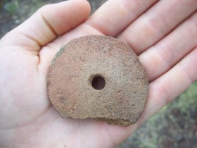 An Ancestral Puebloan spindle whorl used in making textiles.